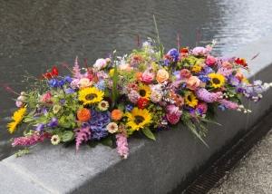 Kistbedekking uitvaartbloemen